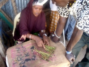 A woman sells miraa in the Somali Market.