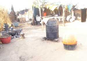 A chang'aa brewing operation in Kakuma