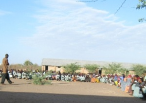 Students gather for assembly at a camp primary school