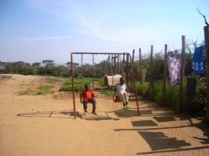 Children play on a swing in a JRS care centre