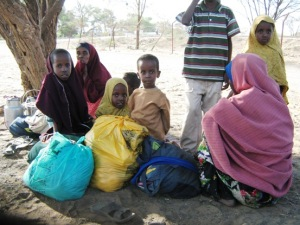 Spontaneous Somali new arrivals wait outside police station