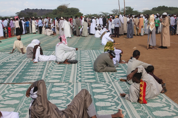 Prayer mats spread out in the field