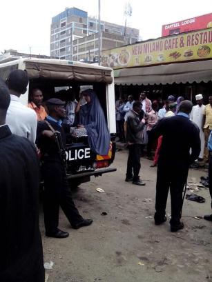 A Muslim lady in the police van